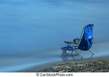 Quietness - Chair sitting at waters edge