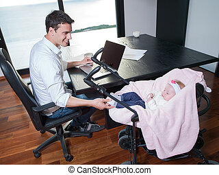 man working from home and take care of baby - young man...