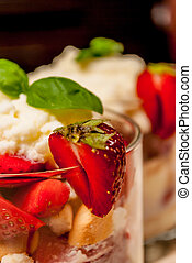 Trifle cake - Trifle or cheesecake with strawberry on wood...