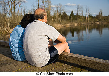 Senior asian couple - A relaxing senior asian couple sitting...