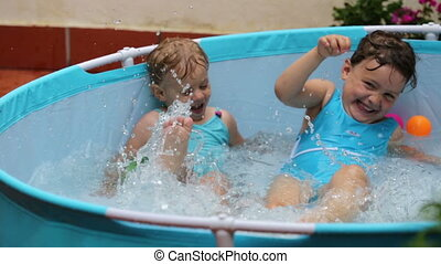 little girls having fun in pool outdoor