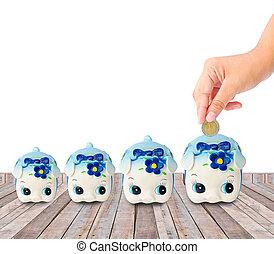 Money Saving with Piggy bank on wood background saving money...