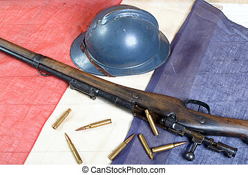 french helmet of the First World War with a gun on a blue...