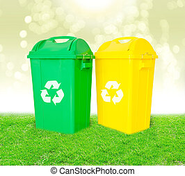 Green and yellow plastic trash recycling container with...