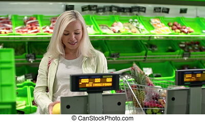 Fruit in Weight - Blond lady in the supermarket checking...