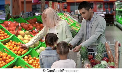 Jubilant Shoppers - Family enjoying grocery shopping,...