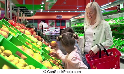 Best for Nearest and Dearest - Mother selecting fruits with...