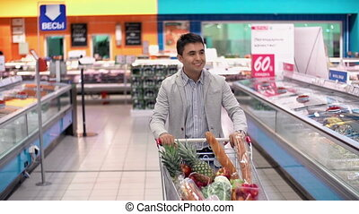 Food Profusion - Guy with full supermarket trolley...