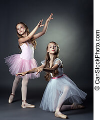 Emotional young ballerinas posing in studio - Image of...