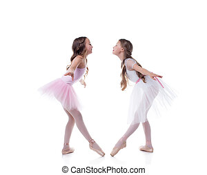 Amusing ballerinas posing looking at each other - Amusing...