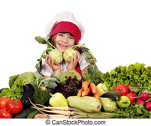 happy little girl cook with vegetables