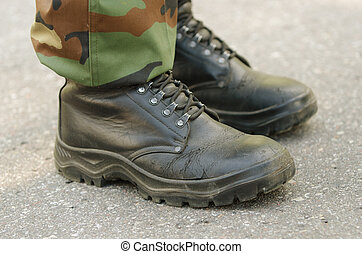 Feet of soldiers in  military boots