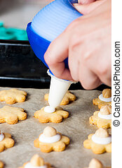 A woman maikng cookies in kitchen