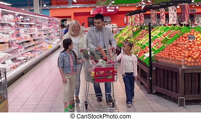 Supermarket Dance - Slow motion of family walking leisurely...