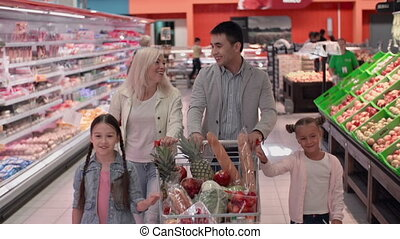 Shopping Fun - Delighted family doing shopping and looking...