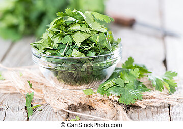 Cilantro Leaves - Portion of fresh green Cilantro leaves on...