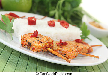 Asian sate skewers with rice on a light background