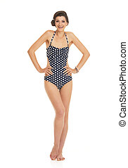 Full length portrait of smiling young woman in swimsuit