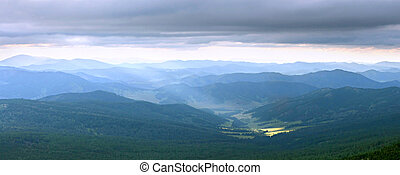 Altai mountains -  dramatic clouds under the Altai mountains