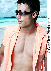 man on the beach - Portrait of attractive man standing with...