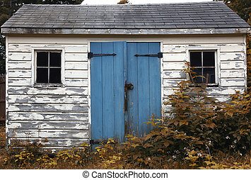 Small Wooden Shack - Small wooden shack with peeling paint...