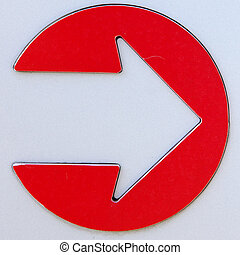 Metal Arrow Sign - Close up of metal sign with red circular...