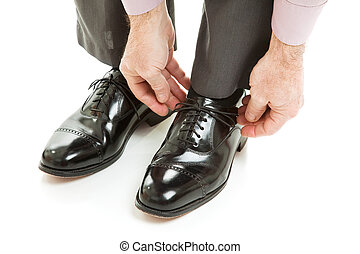 Expensive Mens Shoes - Man ties his shiney new black leather...