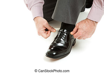 Tying Shoe Lace - Mans hands tying shoelace of his new...