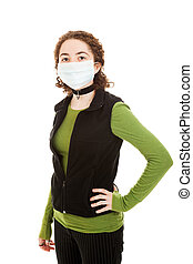 Teen Wearing Flu Mask - Hispanic teen girl wearing a...