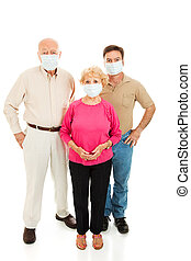 Worried About Flu - Group of adults wearing face masks and...