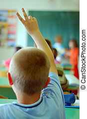 Child rising hand at classroom - Child rising two fingers...