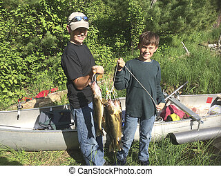 Smartphone picture of two boys showing their catch of...