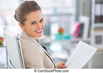 Portrait of business woman with documents in office