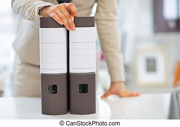 Closeup on business woman with folders