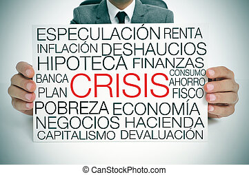 economic crisis, in spanish - a businessman holding a...
