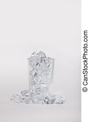 Empty glass filled with ice cubes - Empty glass filled and...