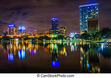 The skyline reflecting in Lake Eola at night, Orlando, Florida.