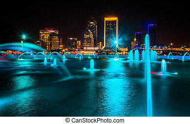 The Friendship Fountains and view of the skyline at night in...