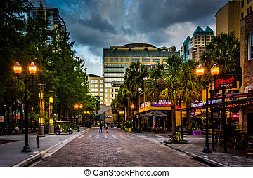 Storm clouds over a brick street in downtown Orlando,...