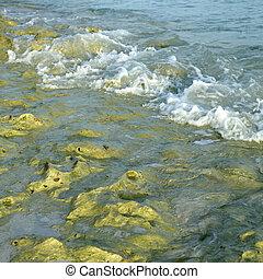 rocky shore - ocean waves crashing on a rocky shore