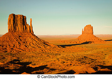 Monument Valley - Sunset on a butte at Monument Valley,...