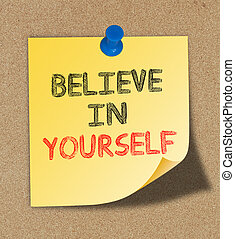 Believe In Yourself written on yellow note pinned on cork...