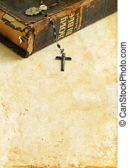 Antique Bible and Rosary on a Grunge Background - Antique...