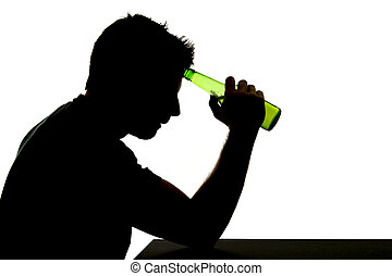 silhouette of alcoholic drunk man drinking beer bottle...