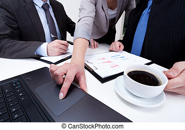 Using laptop on business meeting
