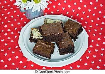 Sweet Spot - Plate of homemade brownies on star background.
