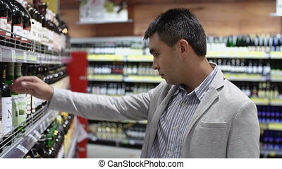 Greased Lightning - Handsome guy of mixed race choosing wine...