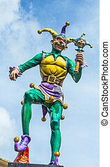 Jester in New Orleans at the river walk area under blue sky