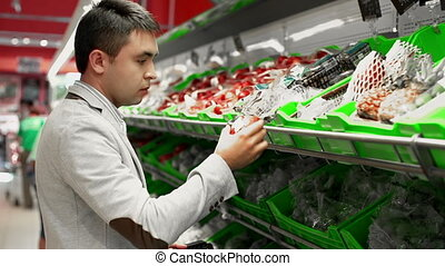 Fruit-Lover - Tracking shot of man in the greengrocery...