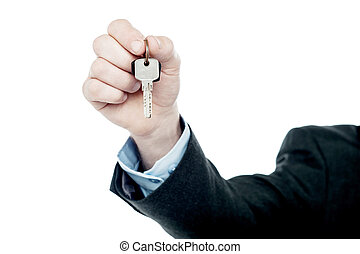 Male hand giving your key, isolated on white